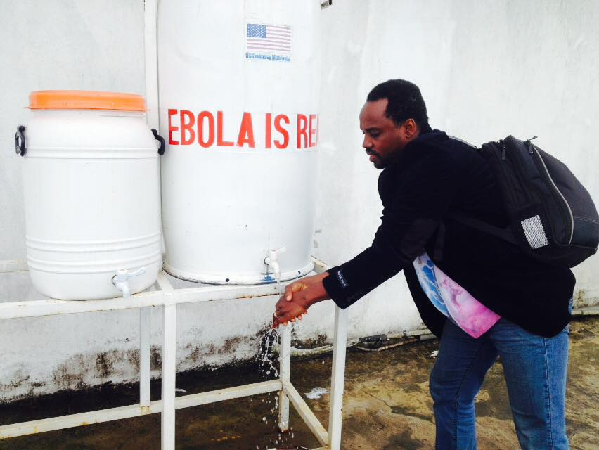 Through our research work at EpiAFRIC, we evaluated the African Union's support to Ebola in West Africa. In this photo,washing my hands with bleach water at Roberts International Airport Monrovia, 2015