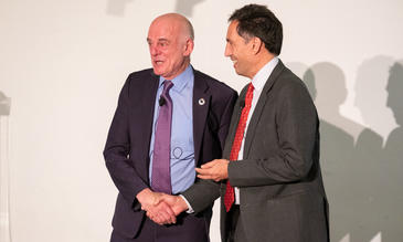Dr David Nabarro (left) receives the Leverhulme medal from LSTM Director David Lalloo