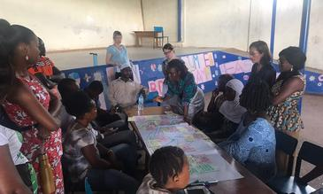 College of Medical and Allied Health Sciences (CoMAHS) team facilitating participatory discussion on non-communicable diseases with residents in Dwarzak informal settlement, Freetown, Sierra Leone. Image copyright: Haja Wurie, College of Medical and Allied Health Sciences (CoMAHS), Sierra Leone.