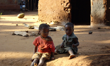 Two children sitting in the dust