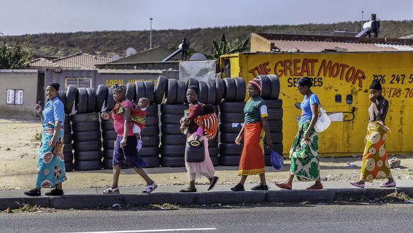 Women walking in Alexandra Township
