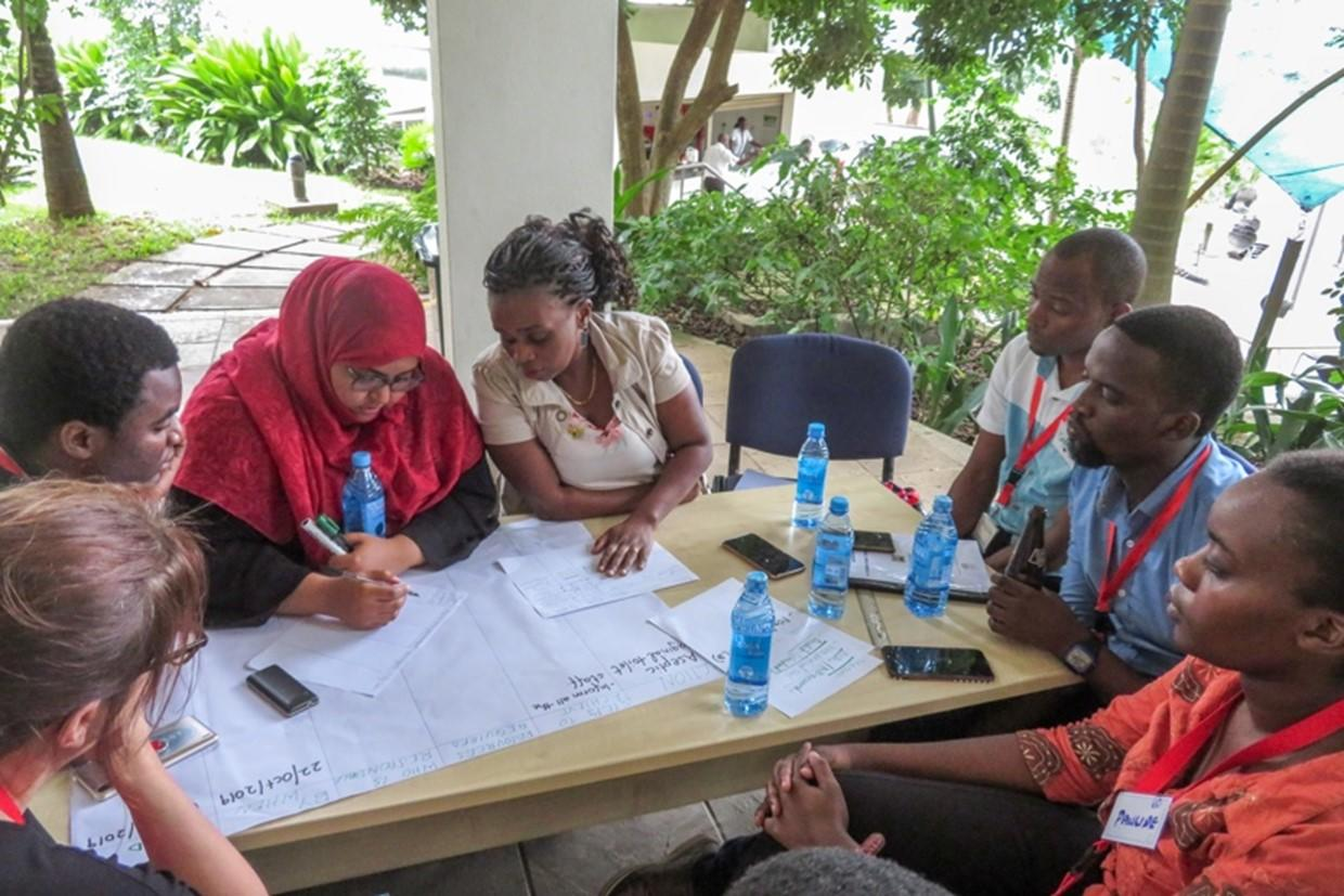 Participants working on facility action plans in Kilifi, Kenya