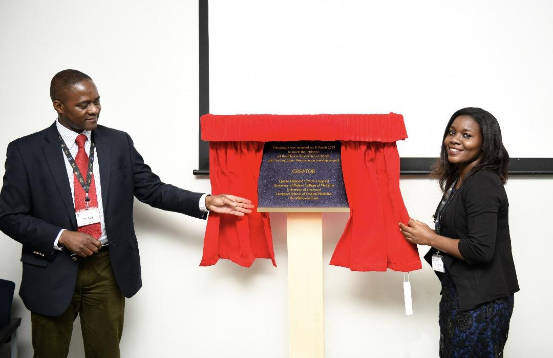 Dr Henry Mwandumba, deputy director of MLW, and Dr Fumbani Limani, clinical research intern of MLW unveiling a plaque to mark the occasion