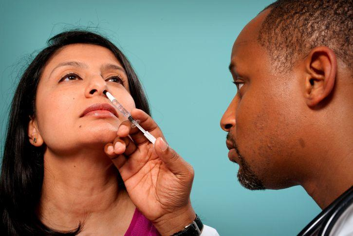 Doctor with nasal spray vaccine