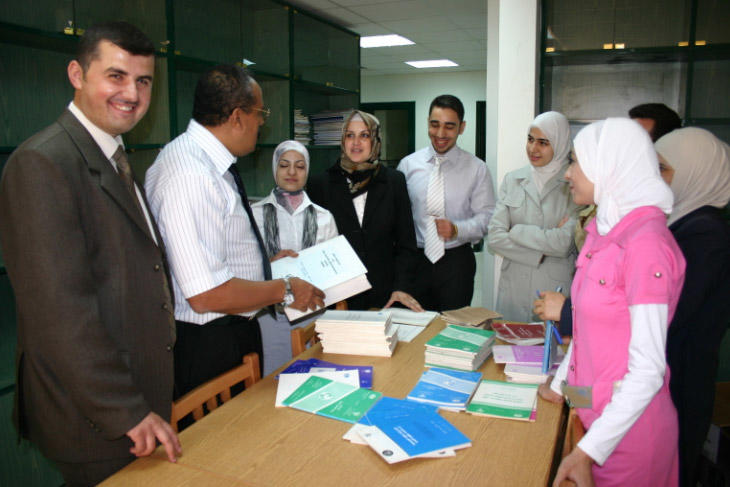 The graduates talking to Dr. Hassan
