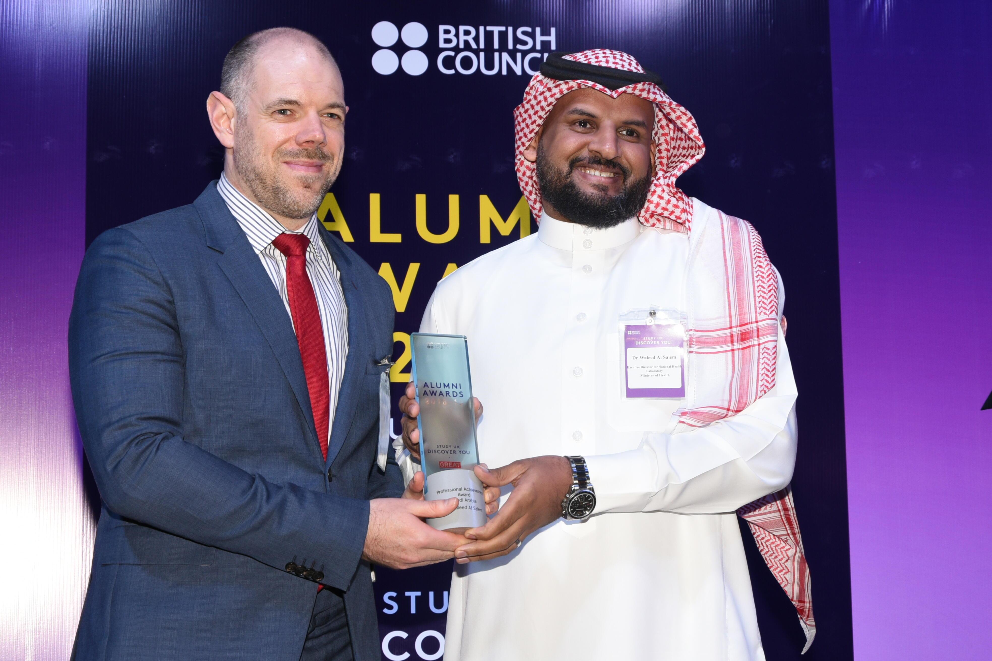 Dr Waleed receiving the award from deputy ambassador Mr Richard Oppenheim