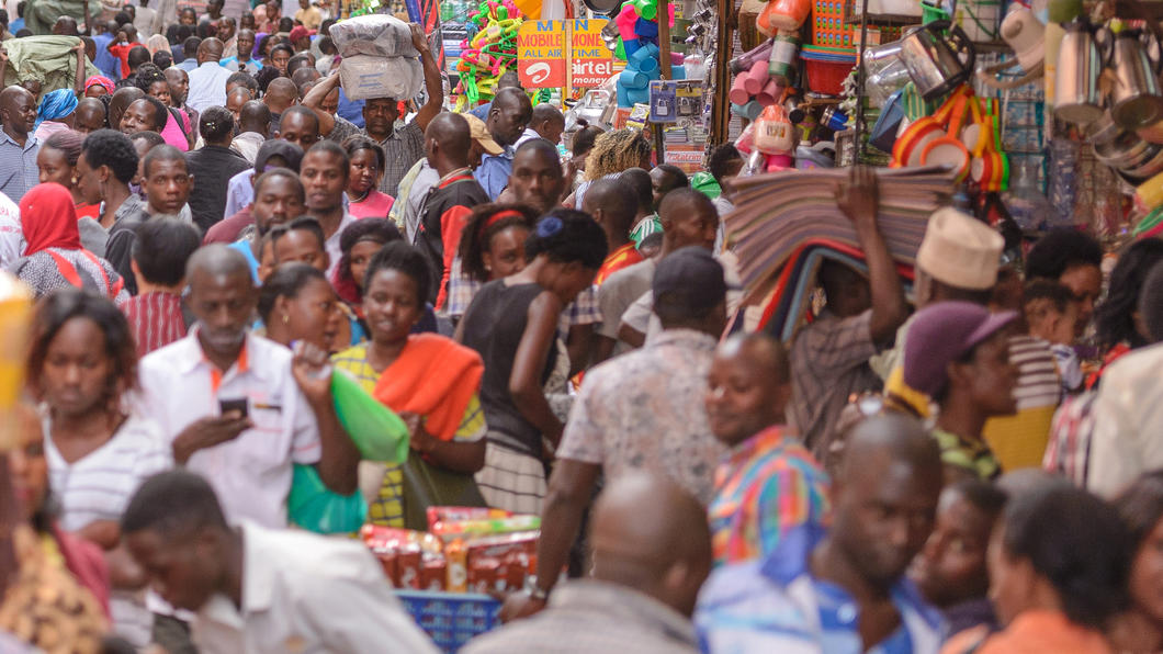 KAMPALA, UGANDA - APRIL 17TH 2018. People go about their everyday business in Kikuubo, one of Kampala's busiest trading areas.