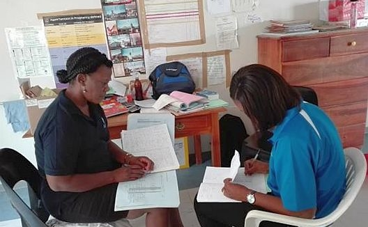 Collecting data at Onyaanya Health Centre