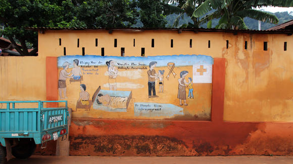 Painted health advice against HIV illness at a wall on a side road between Lomé and Kpalimé near Assahoun in Togo, West Africa.