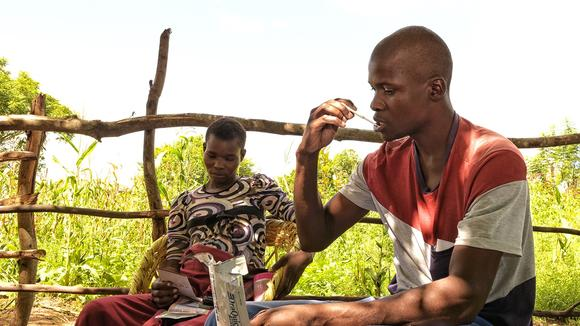 Man using HIV self-testing kit in Zimbabwe - photo credit: UNITAID